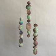 Chris Garofalo. tühi kest, 2020. Glazed porcelain, indian agate and glass beads, 15-13 x 3 x 3 inches, each.