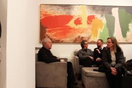 Richard Anuszkiewicz, David Row, and Howard Hurst in front ofKlingsor's Summer (by Friedel Dzubas)