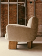 Studio Giancarlo Valle's puff chair with legs, full side view