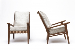 Jacques Adnet's armchair front and side view