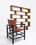 Charlotte Perriand's armchair, installation view with Perriand's bookshelf