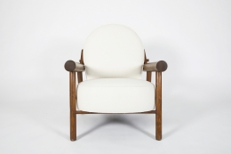 Attributed to Charlotte Perriand, pair of armchairs, single chair eye level front view