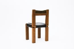 "Pierre Chapo's Set of eight ""S11E"" chairs, single chair back diagonal view"