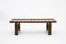Jacques Adnet's coffee table/bench straight view