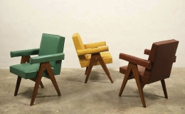 """Three of Le Corbusier & Pierre Jeanneret's """"Committee"""" armchair in green, yellow and red (left to right)"""