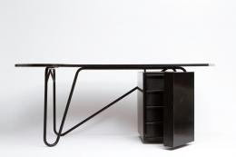 Edgard Pillet's black desk, full view with side cabinet door open