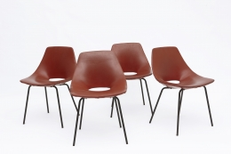 """Pierre Guariche's Set of 4 """"Tonneau"""" chairs straight front view of all chairs"""