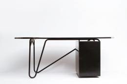 Edgard Pillet's black desk, full view with side cabinet door closed