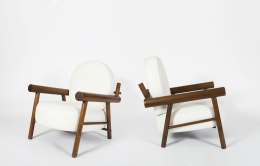 Attributed to Charlotte Perriand, pair of armchairs, diagonal and side views of both chairs