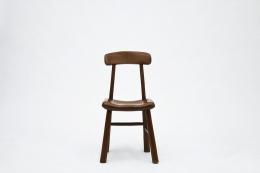 Alexandre Noll's wooden chair, front view