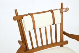 Guillerme et Chambron's pair of armchairs, detailed view of top cushion and wooden frame