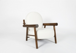 Attributed to Charlotte Perriand, pair of armchairs, single chair diagonal view