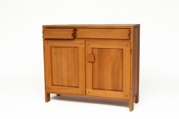 """Pierre Chapo's """"R07"""" sideboard, front diagonal view from above with one drawer slightly opened"""