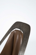 Alain Douillard's leather chair detailed view of metal frame and leather