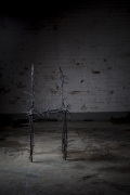 Michele Oka Doner's Terrible Chair, full straight view in a darker warehouse setting