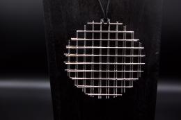 """François Morellet's """"Trame Disques quadrillés argentés"""" necklace, detailed view of pendant"""