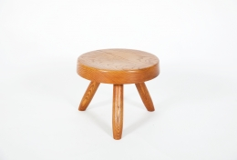 Charlotte Perriand's low stool, full front view from slightly above