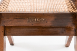 """Pierre Jeanneret's """"Classroom"""" chair, detailed view of marking behind seat"""