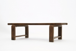 Jacques Adnet's coffee table/bench diagonal view from eye-level