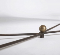 """Jean Royère's """"Ruban"""" coffee table, detailed view of brass component on base"""