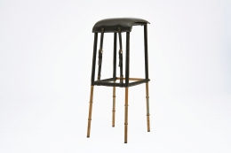 Jacques Adnet pair of bar stools side view