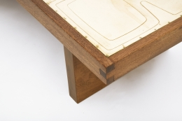 Jany Blazy's coffee table detail of metal top and wood frame