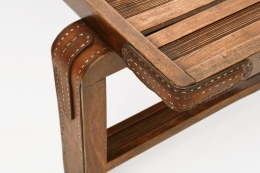 Jacques Adnet's coffee table/bench detailed view of leather and wood