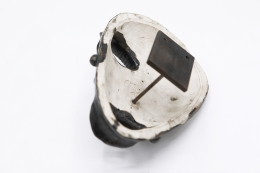Jaque Sagan's ceramic mask, view of the back showing signature and wall mounting element