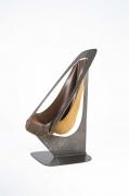 Alain Douillard's leather chair side view