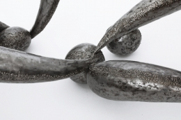 René Broissand's sculptural coffee table detail view of iron legs