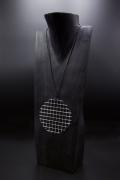 """François Morellet's """"Trame Disques quadrillés argentés"""" necklace, diagonal view"""
