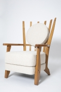 """Guillerme et Chambron's Pair of """" Tapissier"""" armchairs, diagonal front view of single armchair"""