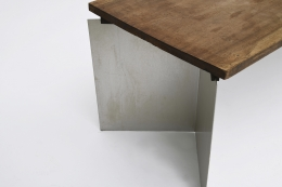 """Jean Paul Barray's """"Hommage à Le Corbusier - Chandigarh"""" table detail of wooden top and leg"""