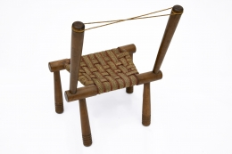 Gaston Castel's wooden chair back view