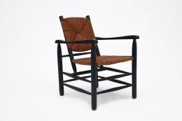 Charlotte Perriand's armchair, full diagonal view