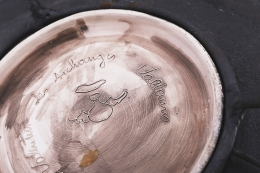 Les Archanges' side table detailed view of signature underneath ceramic plate