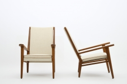 Jacques Adnet's pair of armchairs front and side views
