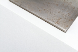 Alain Douillard's iron sculpture, detailed view of signature on base