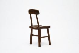 Alexandre Noll's wooden chair, back diagonal view