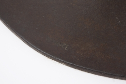 Michel Pinel's iron sculpture, detailed view of signature on base