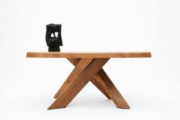 """Pierre Chapo's """"T35C"""" dining table installation view with Alexander Noll's sculpture on top"""