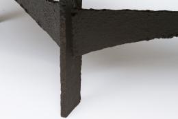 Pia Manu's circular coffee table detailed view of metal leg