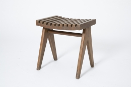 Pierre Jeanneret's pair of stools, full diagonal view of single stool from slightly above