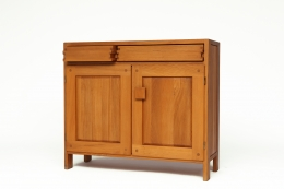 """Pierre Chapo's """"R07"""" sideboard, front diagonal view with one drawer slightly opened"""