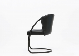 Jacques Adnet chair side view