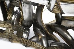 Brutalist cabinet detail of metal base