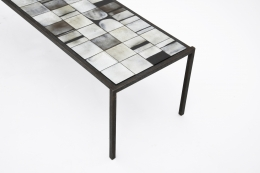 Mado Jolain's ceramic coffee table detailed view of table top and metal frame