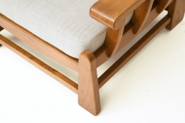 Maison Regain's pair of armchairs, detailed view of upholstery and wood frame