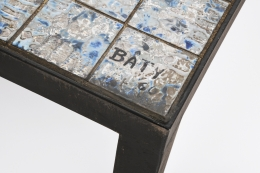 Baty's ceramic coffee table, detailed diagonal view of table top showing signature on corner