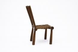 Gaston Castel's wooden chair side view